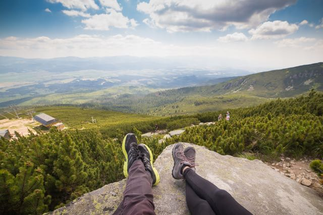 two hikers looking out over a landscape