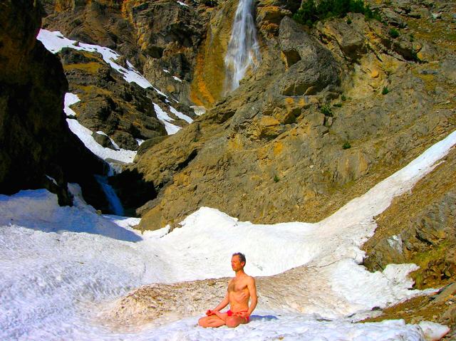 The 'ice man' Wim Hof meditating on snow.